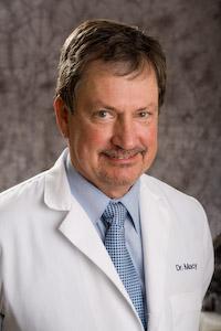 Dr. Dennis Macy